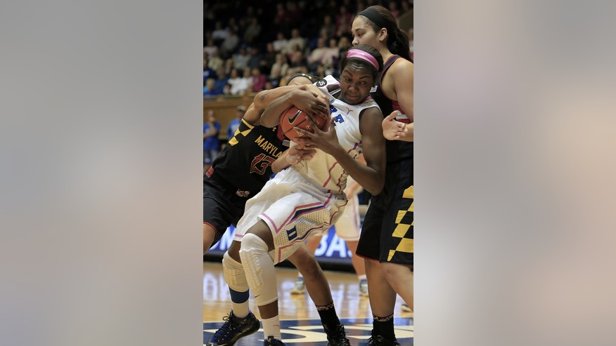 Duke's Elizabeth Williams, center, secures a loose ball between Maryland's Alicia DeVaughn, left, and Brionna Jones, right, during the first half of an NCAA college basketball game in Durham, N.C., Monday, Feb. 17, 2014. Duke led at halftime 38-31. (AP Photo/Ted Richardson)