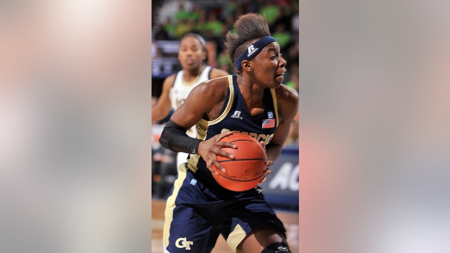 Georgia Tech guard Tyaunna Marshall drives the lane during the first half of an NCAA college basketball game against Notre Dame, Monday, Feb. 17, 2014, in South Bend, Ind. (AP Photo/Joe Raymond)