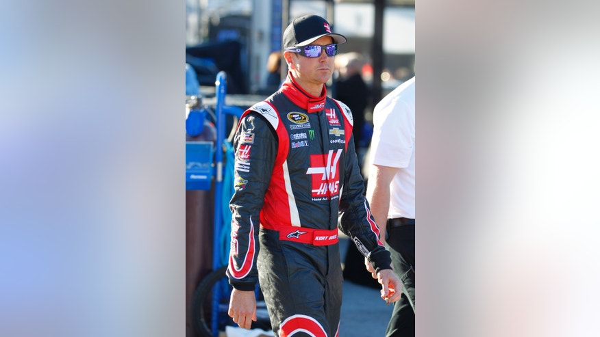 Driver Kurt Busch walks to his garage before practice for the NASCAR Sprint Unlimited auto race at Daytona International Speedway in Daytona Beach, Fla., Friday, Feb. 14, 2014. (AP Photo/Terry Renna)