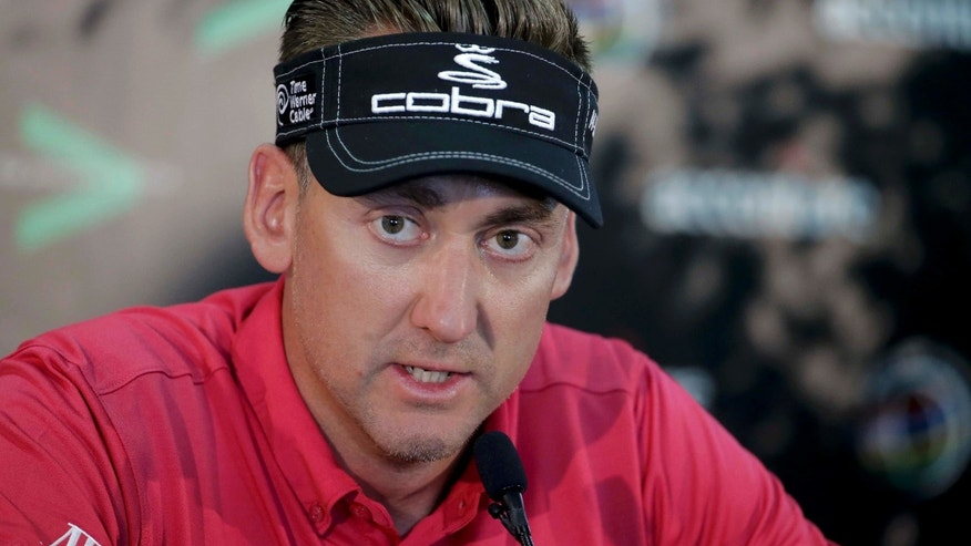 Ian Poulter, of England, answers questions during a news conference for the Match Play Championship golf tournament Tuesday, Feb. 18, 2014, in Marana, Ariz. (AP Photo/Chris Carlson)