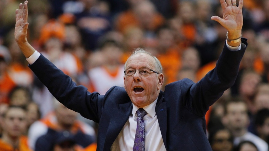 Syracuse coach Jim Boeheim calls out to his players in the second half of an NCAA college basketball game against North Carolina State in Syracuse, N.Y., Saturday, Feb. 15, 2014. Syracuse won 56-55. (AP Photo/Nick Lisi)
