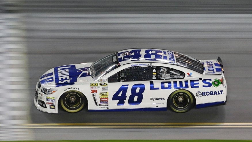 Jimmie Johnson drives through the front stretch during evening practice for the Daytona 500 NASCAR Sprint Cup Series auto race at Daytona International Speedway in Daytona Beach, Fla., Wednesday, Feb. 19, 2014. (AP Photo/John Raoux)