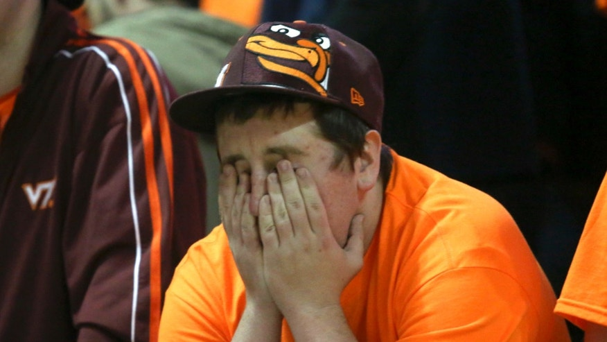 A Virginia Tech fan reacts to his team losing to 57-53 to Virginia in an NCAA college basketball game in Blacksburg, Va., Tuesday, Feb. 18 2014. (AP Photo/The Roanoke Times, Matt Gentry)