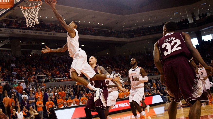 Auburn's Chris Denson (3) hits a layup as Mississippi State's Colin Borchert (3) looks on during an NCAA college basketball game Saturday, Feb. 15, 2014, at Auburn Arena in Auburn, Ala. (AP Photo/The Opelika-Auburn News, Albert Cesare)