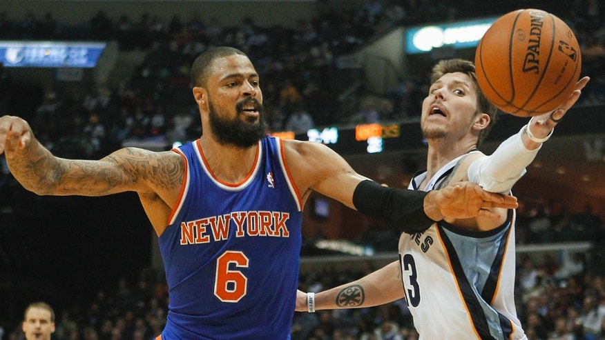 Memphis Grizzlies forward Mike Miller (13) reaches for a rebound against New York Knicks center Tyson Chandler (6) in the first half of an NBA basketball game, Tuesday, Feb. 18, 2014, in Memphis, Tenn. (AP Photo/Lance Murphey)