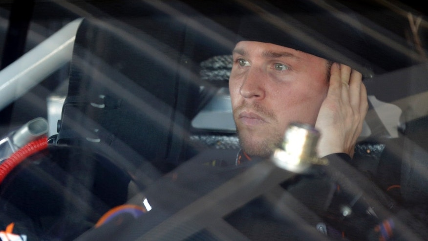 Denny Hamlin looks out from his car before practice for Sunday's NASCAR Daytona 500 Sprint Cup Series auto race at Daytona International Speedway in Daytona Beach, Fla., Wednesday, Feb. 19, 2014. (AP Photo/John Raoux)