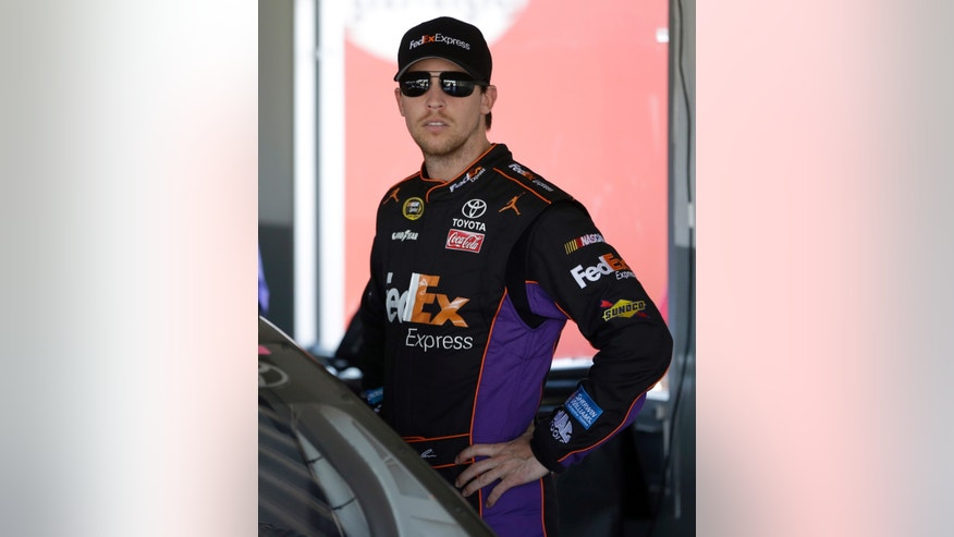 Denny Hamlin looks out of the garage before practice for Sunday's NASCAR Daytona 500 Sprint Cup auto race at Daytona International Speedway in Daytona Beach, Fla., Wednesday, Feb. 19, 2014. (AP Photo/John Raoux)