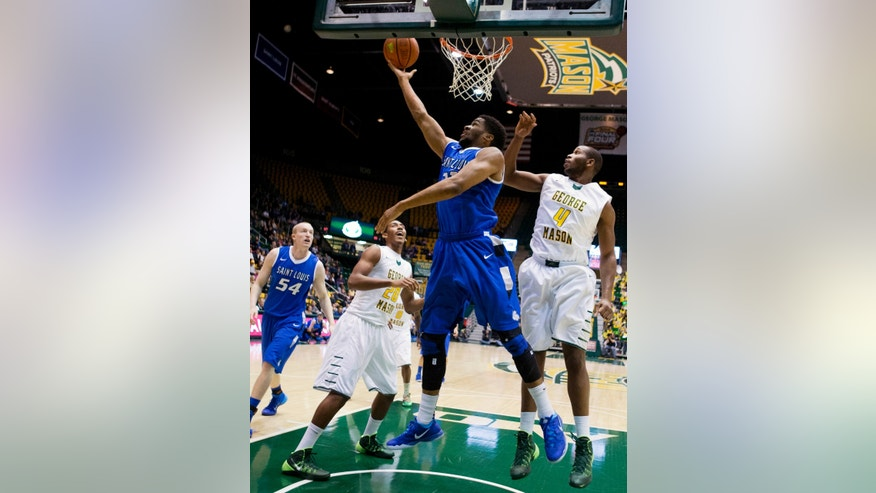 Saint Louis' Dwayne Evans (21) shoots a reverse lay up while George Mason's Jalen Jenkins (20) and Erik Copes (4) look on during the first half of an NCAA college basketball game in Fairfax, Va., Wednesday, Feb. 19, 2014.  (AP Photo/Manuel Balce Ceneta)