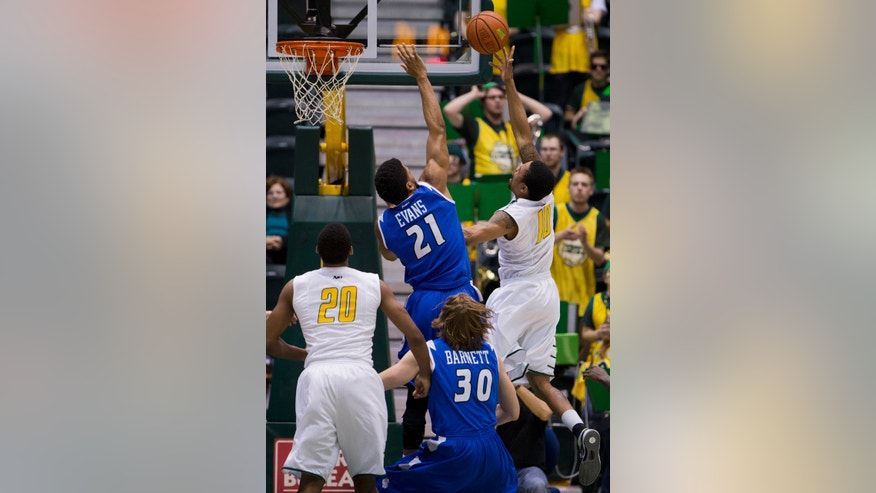 George Mason's Sherrod Wright (10) shoots the ball while Saint Louis' Dwayne Evans (21) defends during the first half of an NCAA college basketball game in Fairfax, Va., Wednesday, Feb. 19, 2014.  (AP Photo/Manuel Balce Ceneta)