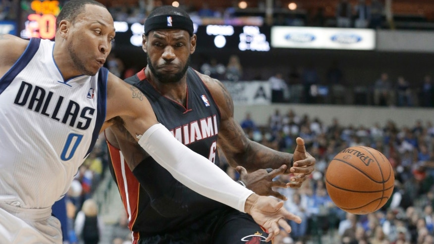 Miami Heat forward LeBron James (6) drives against Dallas Mavericks forward Shawn Marion (0) during the first half of an NBA basketball game Tuesday, Feb. 18, 2014, in Dallas. (AP Photo/LM Otero)