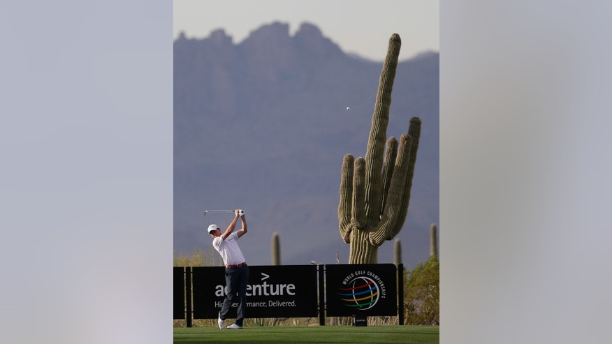 Jimmy Walker watches his tee shot on the fourh hole during the first round of the Match Play Championship golf tournament on Wednesday, Feb. 19, 2014, in Marana, Ariz. (AP Photo/Ted S. Warren)