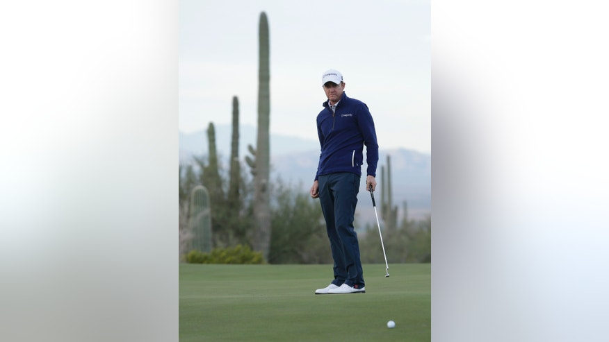 Jimmy Walker watches his putt on the fourth hole during the first round of the Match Play Championship golf tournament on Wednesday, Feb. 19, 2014, in Marana, Ariz. (AP Photo/Ted S. Warren)