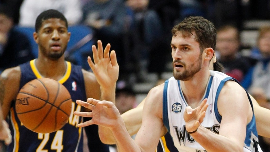 Minnesota Timberwolves forward Kevin Love (42) makes a pass with Indiana Pacers forward Paul George (24) watching during the first half of their NBA basketball game, Wednesday, Feb. 19, 2014 in Minneapolis. (AP Photo/Andy Clayton-King)