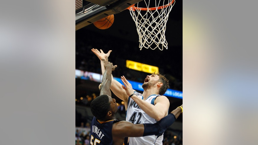 Minnesota Timberwolves forward Kevin Love (42) is fouled by Indiana Pacers center Roy Hibbert (55) during the second period of their NBA basketball game, Wednesday, Feb. 19, 2014 in Minneapolis. (AP Photo/Andy Clayton-King)