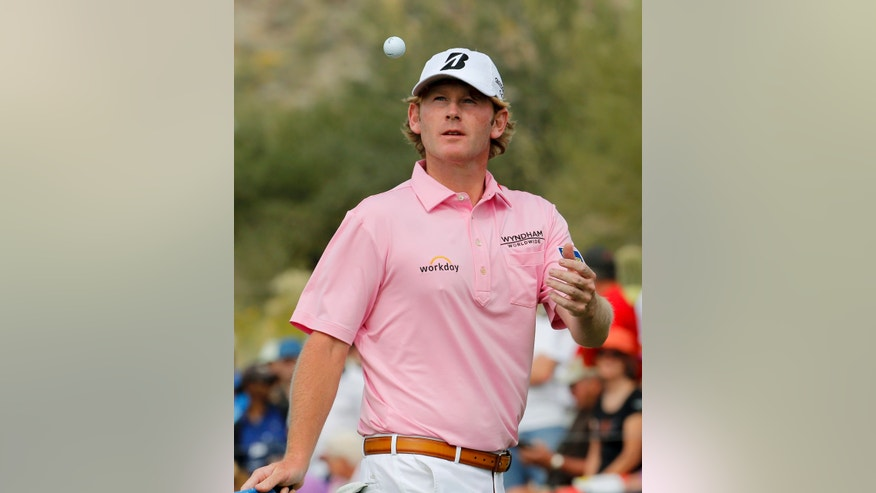 Brandt Snedeker tosses his ball after missing a birdie putt on the 13th hole in his match against David Lynn, of England, during the first round of the Match Play Championship golf tournament on Wednesday, Feb. 19, 2014, in Marana, Ariz. (AP Photo/Matt York)