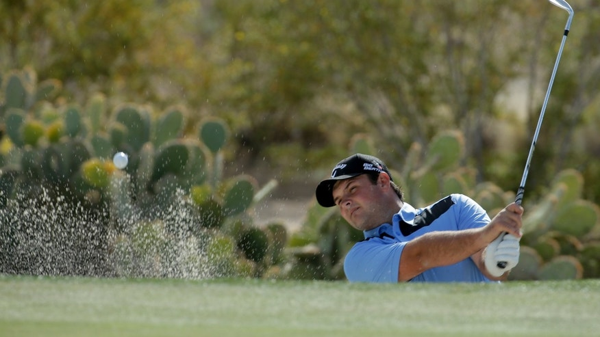Patrick Reed watches his sand shot on the 16th hole during a practice round  for the Match Play Championship golf tournament on Tuesday, Feb. 18, 2014 in Marana, Ariz. (AP Photo/Chris Carlson)
