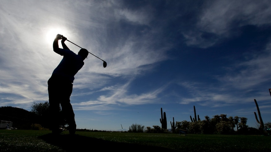 Patrick Reed watches his tee shot on the 17th hole during a practice round  for the Match Play Championship golf tournament on Tuesday, Feb. 18, 2014 in Marana, Ariz. (AP Photo/Chris Carlson)