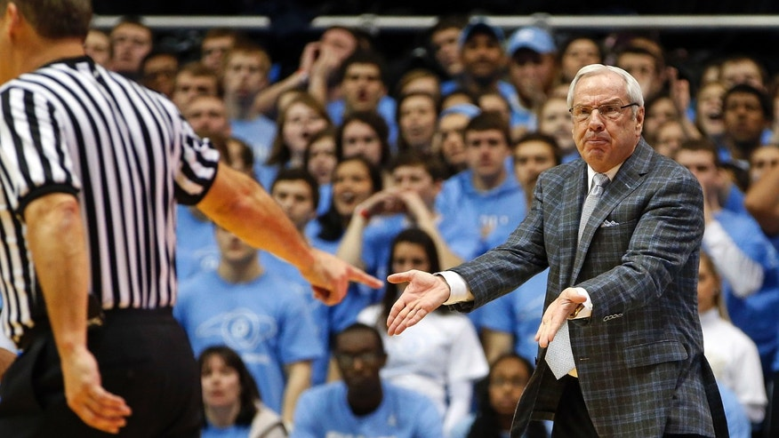 North Carolina head coach Roy Williams protests a call with an official during the first half of an NCAA college basketball game against the Pittsburgh in Chapel Hill, N.C., Saturday, Feb. 15, 2014. North Carolina won 75-71. (AP Photo/Karl B DeBlaker)