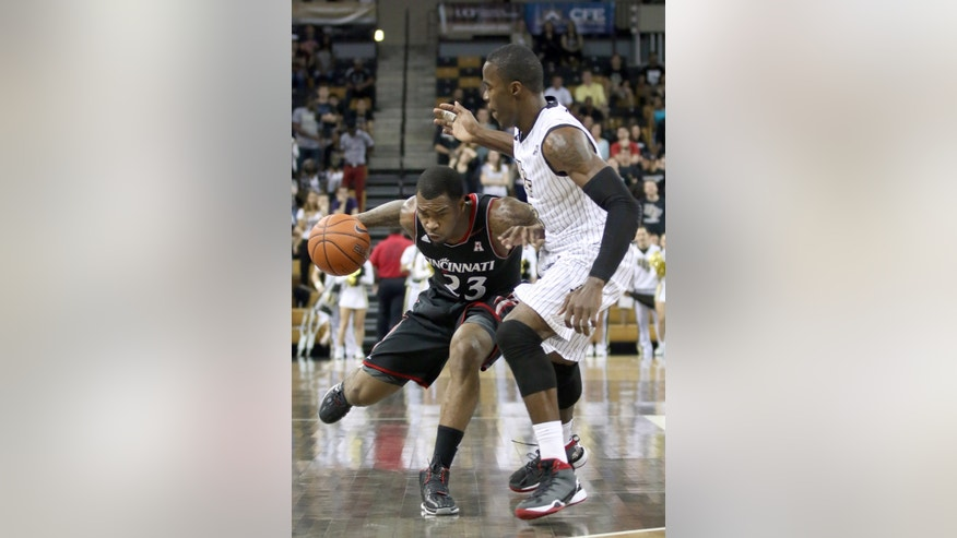 Cincinnati guard Sean Kilpatrick (23) is guarded by Central Florida forward Isaiah Sykes (3) during the second half of an NCAA basketball game, Wednesday, Feb. 19, 2014, in Orlando Fla. Cincinnati won 77-49. (AP Photo Reinhold Matay)