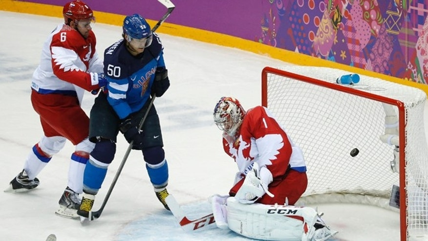 Feb. 19, 2014: Finland forward Juhamatti Aaltonen (50) scores against Russia defenseman Nikita Nikitin, left, and Russia goaltender Semyon Varlamov in the first period of a men's quarterfinal ice hockey game at the 2014 Winter Olympics in Sochi, Russia.