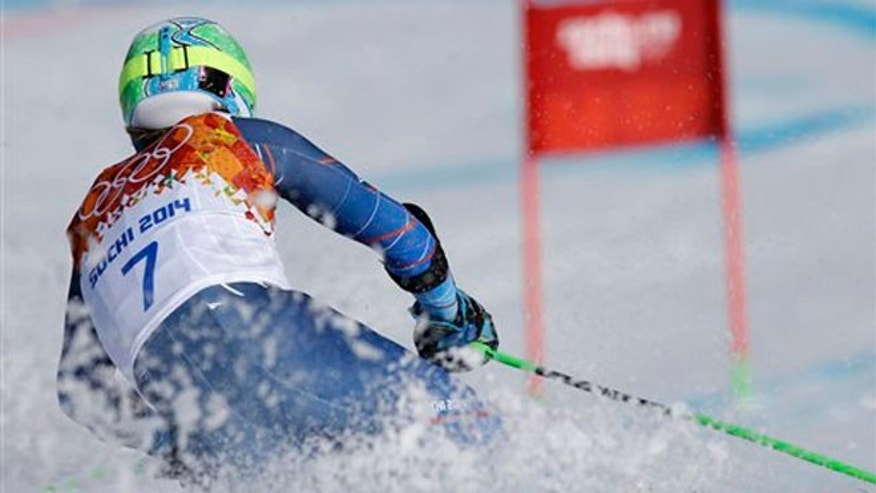 Gold medal winner, United States' Ted Ligety skis in the second run of the men's giant slalom to the Sochi 2014 Winter Olympics, Wednesday, Feb. 19, 2014, in Krasnaya Polyana, Russia.