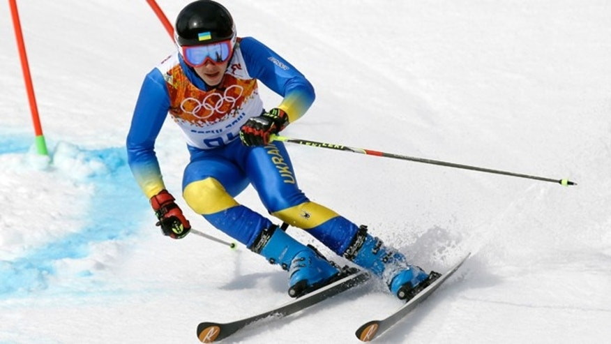 Feb. 19, 2014: Ukraine's Dmytro Mytsak passes a gate in the first run of the men's giant slalom at the Sochi 2014 Winter Olympics, Wednesday, in Krasnaya Polyana, Russia.
