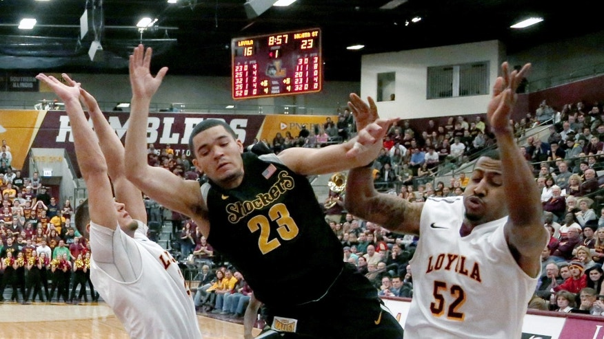 Wichita State guard Fred VanVleet (23) loses the ball after being fouled by Loyola of Chicago guard Tony Nixon (52) as Nick Osborne, left, also defends, during the first half of an NCAA college basketball game Wednesday, Feb. 19, 2014, in Chicago. (AP Photo/Charles Rex Arbogast)