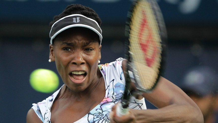 Venus Williams of the U.S. returns the ball to Ana Ivanovic of Serbia during the third day of Dubai Duty Free Tennis Championships in Dubai, United Arab Emirates, Wednesday, Feb. 19, 2014. (AP Photo/Kamran Jebreili)