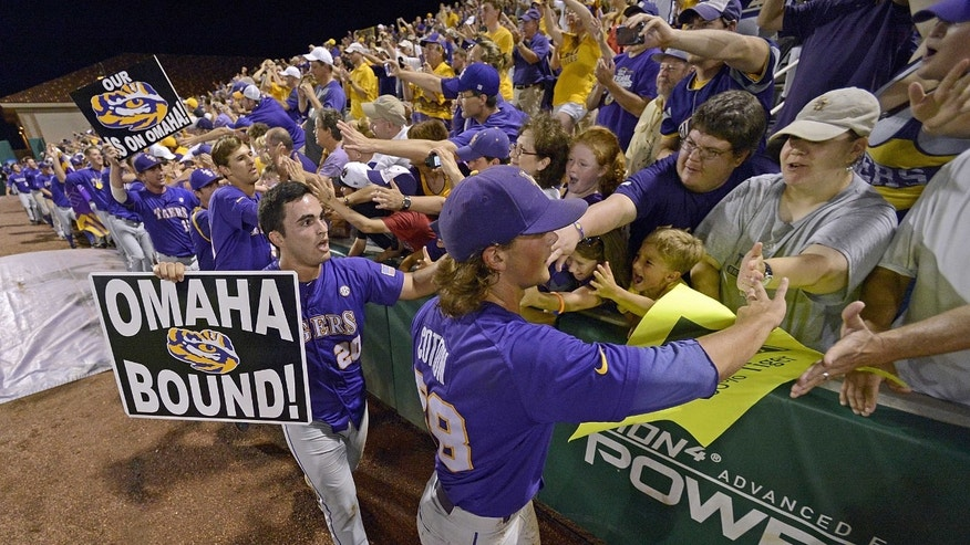 ADVANCE FOR WEEKEND EDITIONS, FEB. 22-23 - FILE - In this June 8, 2013 file photo, Chris Chinea (20) and closing pitcher Chris Cotton (58) thanks the fans as the LSU team makes the circuit around the stadium after an NCAA college baseball tournament super regional game against Oklahoma, in Baton Rouge, La.  SEC teams have played in the championship game in each of the last six years, with three _ LSU in 2009, and South Carolina in 2010 and '11 _ winning it all. (AP Photo/Bill Feig, File)