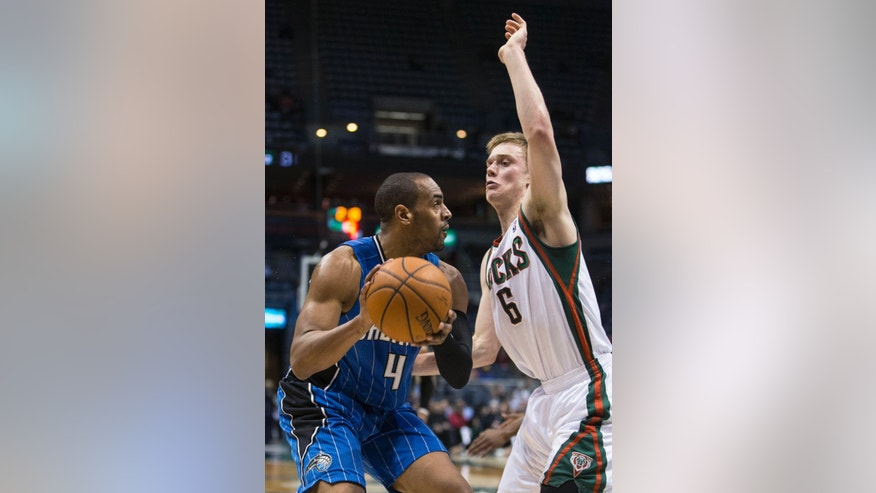 Milwaukee Bucks' Nate Wolters stops the drive of Orlando Magic's Arron Afflalo during the first half of an NBA basketball game Tuesday, Feb. 18, 2014, in Milwaukee. (AP Photo/Tom Lynn)
