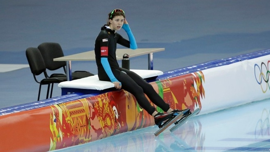 Feb. 19, 2014: Maria Lamb of the U.S. rests after competing in the women's 5,000-meter speedskating race at the Adler Arena Skating Center during the 2014 Winter Olympics in Sochi, Russia.