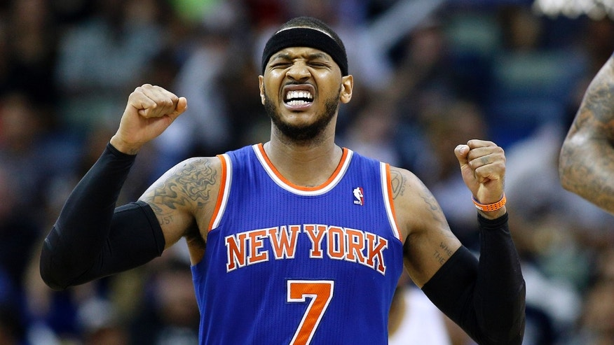 New York Knicks small forward Carmelo Anthony (7) celebrates after scoring during the second half of an NBA basketball game against the New Orleans Pelicans in New Orleans, Wednesday, Feb. 19, 2014. The Knicks won 98-91. (AP Photo/Jonathan Bachman)