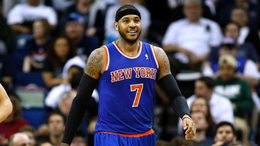 New York Knicks small forward Carmelo Anthony (7) smiles after scoring during the second half of an NBA basketball game against the New Orleans Pelicans in New Orleans, Wednesday, Feb. 19, 2014. The Knicks won 98-91. (AP Photo/Jonathan Bachman)