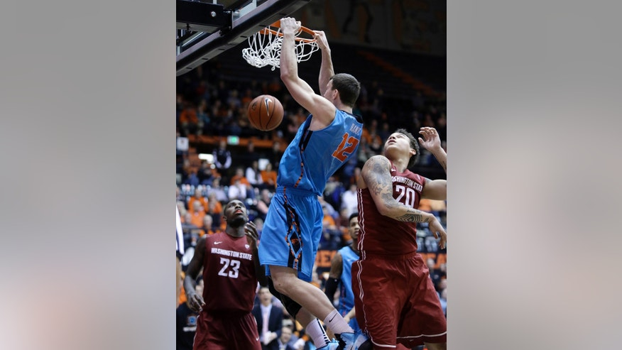 Oregon State center Angus Brandt, from Australia, middle, scores against Washington State's D.J. Shelton, left, and Jordan Railey during the second half of an NCAA basketball game in Corvallis, Ore., Thursday, Feb. 20, 2014. (AP Photo/Don Ryan)