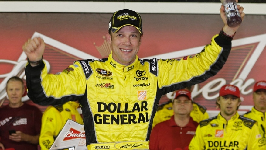 Matt Kenseth celebrates in Victory Lane after winning the first of two NASCAR Sprint Cup series qualifying auto races at Daytona International Speedway in Daytona Beach, Fla., Thursday, Feb. 20, 2014. (AP Photo/Chuck Burton)