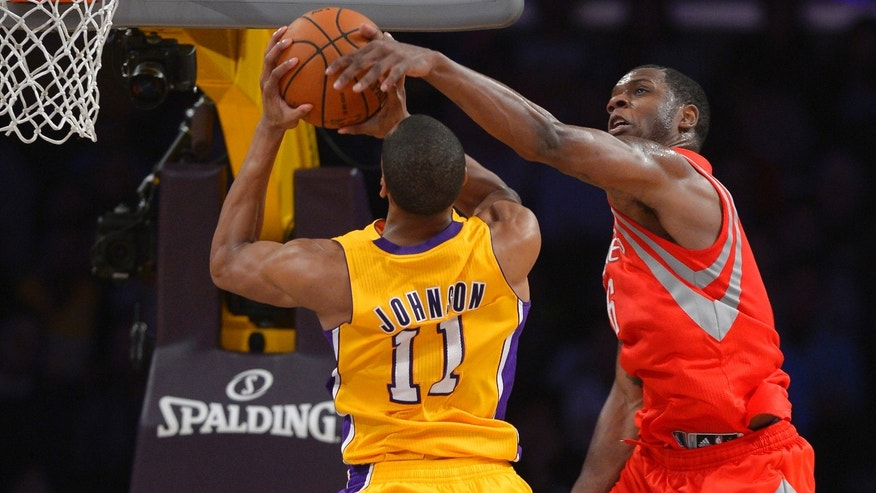 Los Angeles Lakers forward Wesley Johnson, left, goes up for a shot as Houston Rockets forward Terrence Jones defends during the second half of an NBA basketball game, Wednesday, Feb. 19, 2014, in Los Angeles. (AP Photo/Mark J. Terrill)