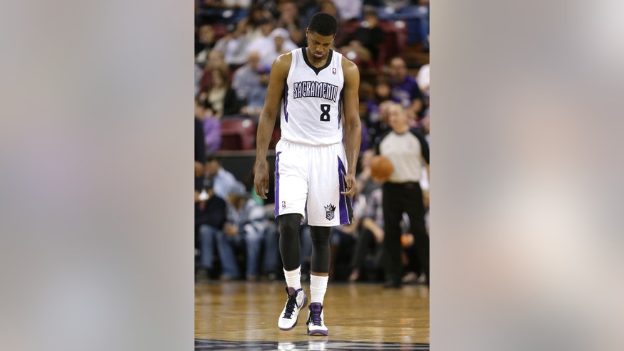 Sacramento Kings forward Rudy Gay walks down court in the closing moments of the Kings 101-92 loss to the Golden State Warriors in a NBA basketball game in Sacramento, Calif., Wednesday, Feb. 19, 2014. (AP Photo/Rich Pedroncelli)