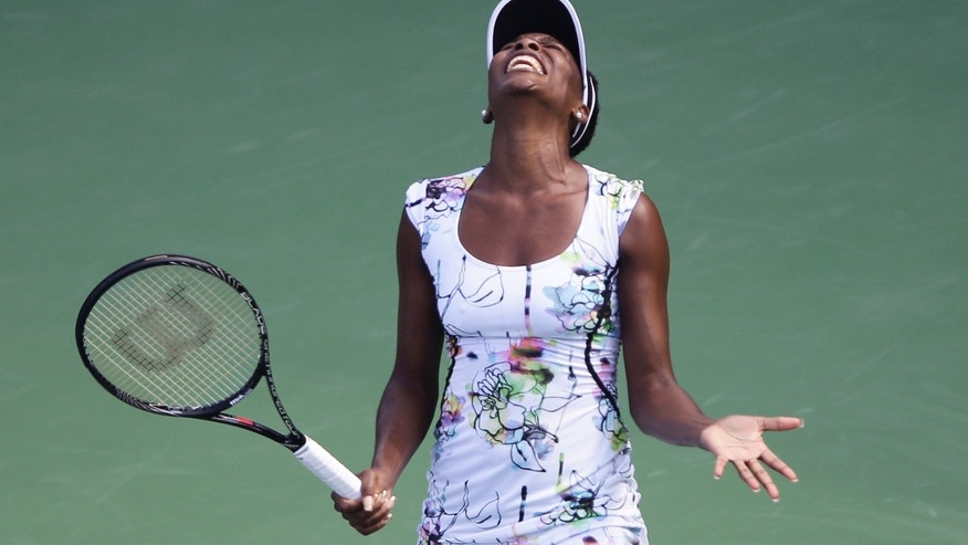 Venus Williams of the U.S. reacts during a match against Flavia Pennetta of Italy during the quarter final of Dubai Duty Free Tennis Championships in Dubai, United Arab Emirates, Thursday, Feb. 20, 2014. (AP Photo/Kamran Jebreili)