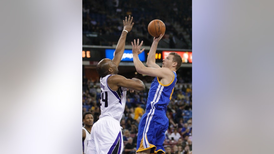 Golden State Warriors forward David Lee, right, shoots over Sacramento Kings forward Carl Landry during the first quarter of an NBA basketball game in Sacramento, Calif., Wednesday, Feb. 19, 2014. (AP Photo/Rich Pedroncelli0