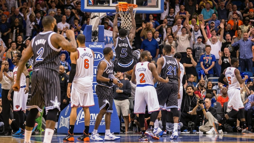 Orlando Magic's Victor Oladipo (5) dunks during the second overtime of an NBA basketball game against the New York Knicks in Orlando, Fla., Friday, Feb. 21, 2014. The Magic won 129-121. (AP Photo/Willie J. Allen Jr.)