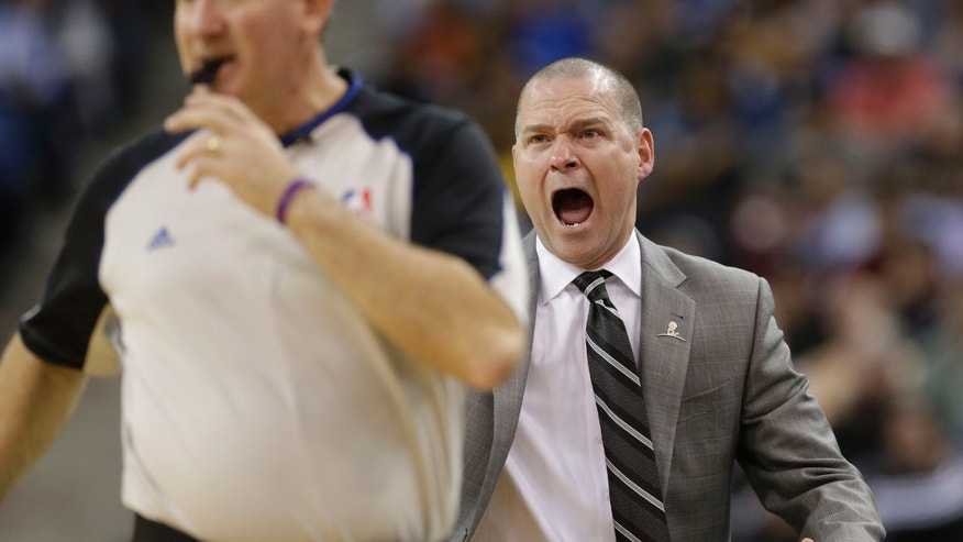 Sacramento Kings head coach Michael Malone, right, shouts at Official Scott Wall about a call during the fourth quarter of an NBA basketball game against12Golden State Warriors in Sacramento, Calif., Wednesday, Feb. 19, 2014. The Warriors won 101-92.(AP Photo/Rich Pedroncelli0