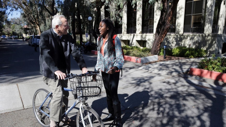 ADVANCE FOR WEEKEND EDITIONS, FEB. 22-23 - In this Feb. 19, 2014 photo, Chiney Ogwumike, a member of Stanford's NCAA college basketball team, talks to History professor Norman Naimark on the university's campus in Stanford, Calif. (AP Photo/Marcio Jose Sanchez)