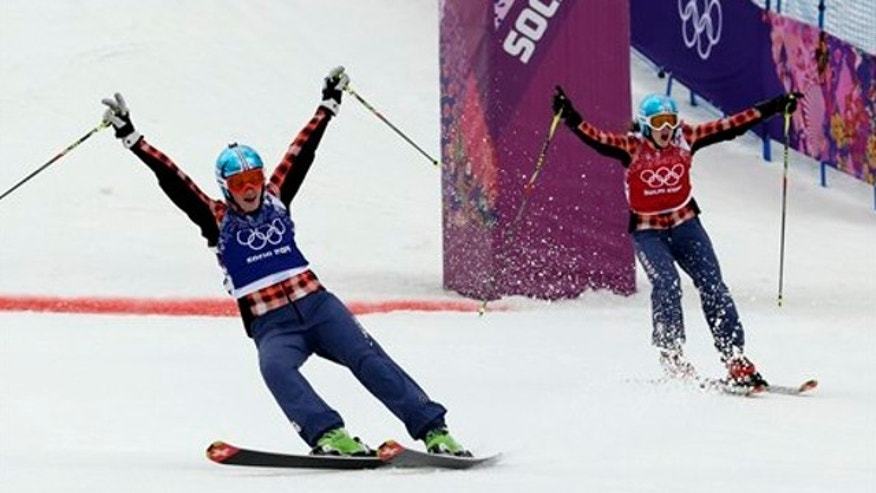 Feb. 21, 2014: Canada's Marielle Thompson, left, celebrates winning the gold medal ahead of compatriot Kelsey Serwa right, in the women's ski cross final at the Rosa Khutor Extreme Park, at the 2014 Winter Olympics.