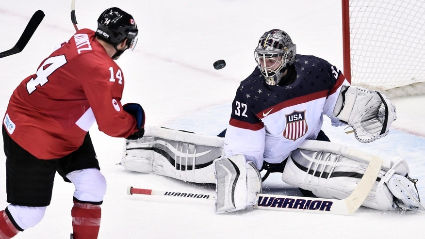 Kunitz of Canada, shot is stopped by United States' goaltender Jonathan Quick of the United States  during the third period of the men's semifinal ice hockey game at the 2014 Winter Olympics, Friday, Feb. 21, 2014, in Sochi, Russia. Canada defeated the United States 1-0.  (AP Photo/The Canadian Press, Nathan Denette)