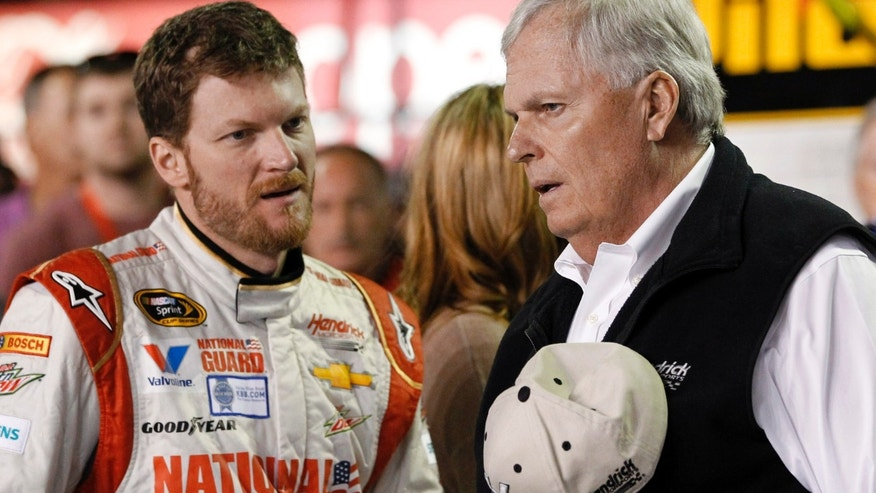 Dale Earnhardt Jr., left, talks with team owner Rick Hendrick before the first of two NASCAR Sprint Cup series qualifying auto races at Daytona International Speedway in Daytona Beach, Fla., Thursday, Feb. 20, 2014. (AP Photo/Terry Renna)