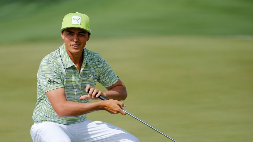 Rickie Fowler marks his ball on the sixth hole in his match against Sergio Garcia, of Spain,  during the third round of the Match Play Championship golf tournament on Friday, Feb. 21, 2014, in Marana, Ariz. (AP Photo/Matt York)