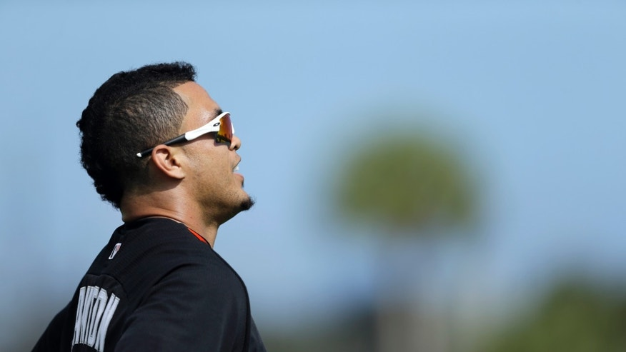 Miami Marlins' Giancarlo Stanton pauses after running sprints with his teammates during spring training baseball practice, Thursday, Feb. 20, 2014, in Jupiter, Fla. (AP Photo/Jeff Roberson)