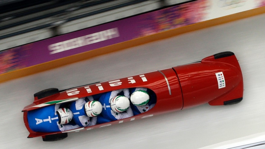 Feb. 20, 2014 - The team from Italy ITA-1, piloted by Simone Bertazzo, take a curve during the men's four-man bobsled training at the 2014 Winter Olympics, in Krasnaya Polyana, Russia.