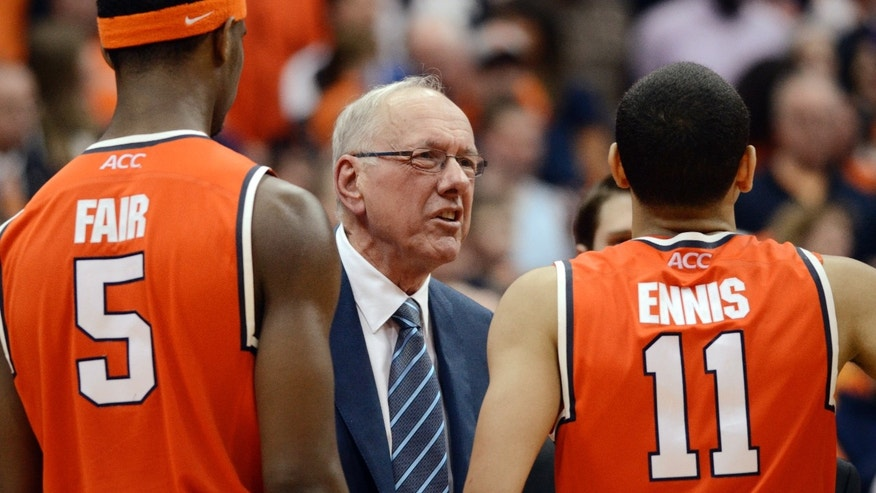 Syracuse coach Jim Boeheim talks with Tyler Ennis during a timeout against Boston College in an NCAA college basketball game in Syracuse, N.Y., Wednesday, Feb. 19, 2014. Boston College defeated Syracuse 62-59 in overtime. (AP Photo/Kevin Rivoli)