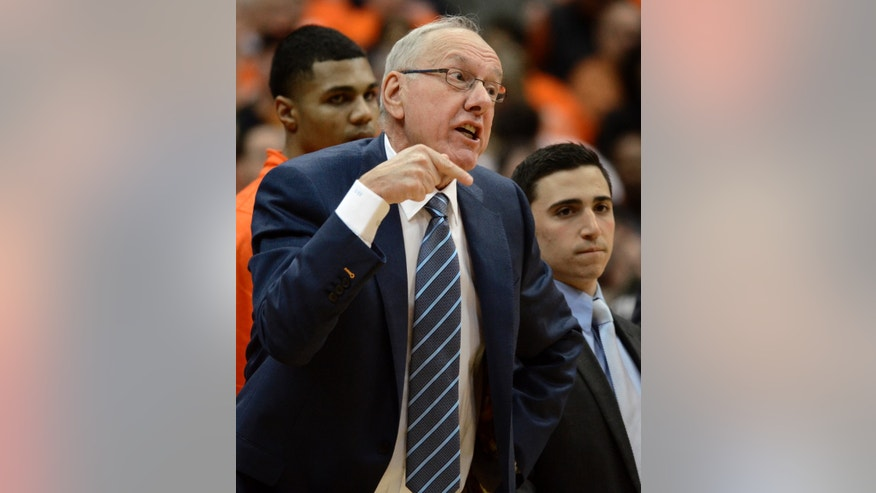 Syracuse coach Jim Boeheim yells to Tyler Ennis during the first half against Boston College in an NCAA college basketball game in Syracuse, N.Y., Wednesday, Feb. 19, 2014. (AP Photo/Kevin Rivoli)
